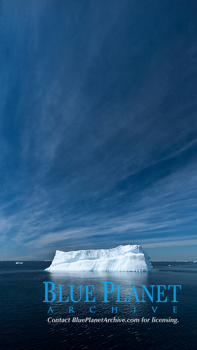 Iceberg, clouds and sky, Antarctica.