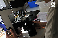 Researcher looking through microscope (Licence this image exclusively with Getty: http://www.gettyimages.com/detail/97538624 )