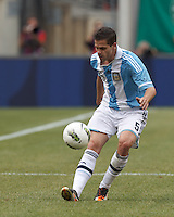 Argentina midfielder Fernando Gago (5) passes the ball down the wing. In an international friendly (Clash of Titans), Argentina defeated Brazil, 4-3, at MetLife Stadium on June 9, 2012.