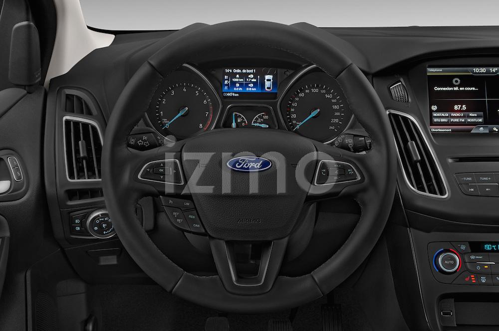 Car pictures of steering wheel view of a 2015 Ford Focus Titanium 5 Door Hatchback Steering Wheel