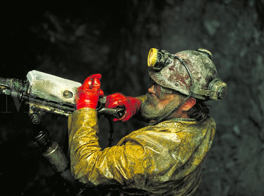 A miner uses a jackleg drill inside Greens Creek Mine on Admiralty Island, Alaska. (Southeast Alaska). Alaska, Greens Creek Mine, Admiralty Island, Southeast Alaska.