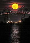 May's full moon rising over the Richmond San Rafael Bridge midspan.