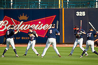 The Virginia Cavaliers warm up in the outfield prior to the game against the Duke Blue Devils at Durham Bulls Athletic Park on April 20, 2012 in Durham, North Carolina.  The Blue Devils defeated the Cavaliers 6-3.  (Brian Westerholt/Four Seam Images)