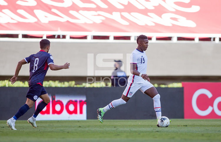 ZAPOPAN, MEXICO - MARCH 21: Andres Perea #15 of the United States dribbles with the ball during a game between Dominican Republic and USMNT U-23 at Estadio Akron on March 21, 2021 in Zapopan, Mexico.
