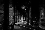 A monochrome image of the interior of the Colosseum in Rome, Italy