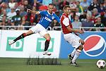 Kenny Miller slams a shot past Fury defender Omar Jarun but his effort is saved