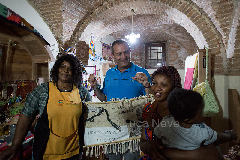 """Luigi De Magistris (Mayor of Naples).<br /> <br /> Riace (Calabria, Italy), 04/08/2018. Visiting Riace for the third day of the """"Riace in Festival"""", 'Festival delle Migrazioni e delle Culture Locali' (Festival of Migration and Local Cultures). Attending the festival, amongst others, were the Mayor of Napoli Luigi De Magistris and the Mayor of Barcelona Ada Colau, debating with the Mayor of Riace, Domenico 'Mimmo' Lucano, about the so called """"migration crisis"""", as well as the now famous """"Modello Riace"""" (The Riace Model: how to welcome and work with Migrants to invest in building a future together). Other speakers included: Tiziana Barillà, Journalist at """"il Salto"""" (1) and Author of the book """"Mimi Capatosta. Mimmo Lucano e il modello Riace"""" (2), Magistrates Riccardo De Vito and Emilio Sirianni (in turn President and Member of Magistratura Democratica). Chair of the event was Ilaria Bonaccorsi, Historian & Journalist at """"il Salto"""".<br /> From the Festival website: """"RIACE in FESTIVAL, is an event born in the wake of the policy of reception and resettlement of refugees and asylum seekers that the city administration of the """"Riace Bronzes'"""" town has been implementing for years. [...] The festival aims to be a concrete initiative that, through the universal language of cinema and the arts, promotes the exchange and mutual knowledge to counteract forms of closure and racism, drawing attention to the innovative path that the municipal administration of Riace has started by combining the reception of migrants with the revival of its territory and giving the image of an unpublished Calabria, different from that of the black chronicle>>.<br /> Riace is a small village in the province of Reggio Calabria. It's famous because on the 16 August 1972...<br /> <br /> (For the full caption read the ARTICLE at the the beginning of this story)"""