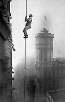 """The """"Human Squirrel"""" who did many daring """"stunts"""" in climbing for benefit of War Relief Funds in New York City.  He is shown here at a dizzy height in Times Square.  Ca.  1918.  Times Photo Service. (War Dept.)<br />Exact Date Shot Unknown<br />NARA FILE #:  165-WW-578B-6<br />WAR & CONFLICT BOOK #:  521"""