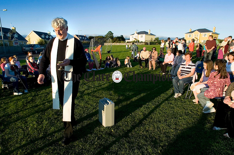Fr Harry Bohan, PP,  gives out holy communion at an open air mass at Ballymulcashel, Kilmurry as part of the Friends And Neighbour's Gathering, organised by the Sixmilebridge Parish Council. Photograph by John Kelly.