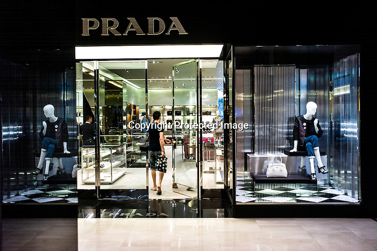 A shopper walks in to a the Prada store at the Pavilion, a high end shopping mall in Kuala Lumpur, Malaysia.