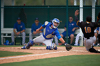 Toronto Blue Jays Justin Atkinson (50) attempts to tag Pablo Reyes (18) sliding home during a minor league Spring Training game against the Pittsburgh Pirates on March 24, 2016 at Pirate City in Bradenton, Florida.  (Mike Janes/Four Seam Images)