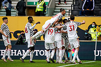 23rd May 2021; Molineux Stadium, Wolverhampton, West Midlands, England; English Premier League Football, Wolverhampton Wanderers versus Manchester United; Manchester United players celebrate after Juan Mata scores in the last minute of the first half for 2-1 lead