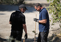 FAO JANET TOMLINSON, DAILY MAIL PICTURE DESK<br /> Pictured: Special forensics police officers examine one of their finding during a search a field in Kos, Greece. Sunday 02 October 2016<br /> Re: Police teams led by South Yorkshire Police, searching for missing toddler Ben Needham on the Greek island of Kos have moved to a new area in the field they are searching.<br /> Ben, from Sheffield, was 21 months old when he disappeared on 24 July 1991 during a family holiday.<br /> Digging has begun at a new site after a fresh line of inquiry suggested he could have been crushed by a digger.
