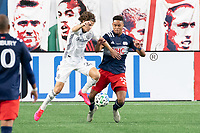 FOXBOROUGH, UNITED STATES - AUGUST 20: Brenden Aaronson #22 of Philadelphia Union tackles Brandon Bye #15 of New England Revolution during a game between Philadelphia Union and New England Revolution at Gilette on August 20, 2020 in Foxborough, Massachusetts.