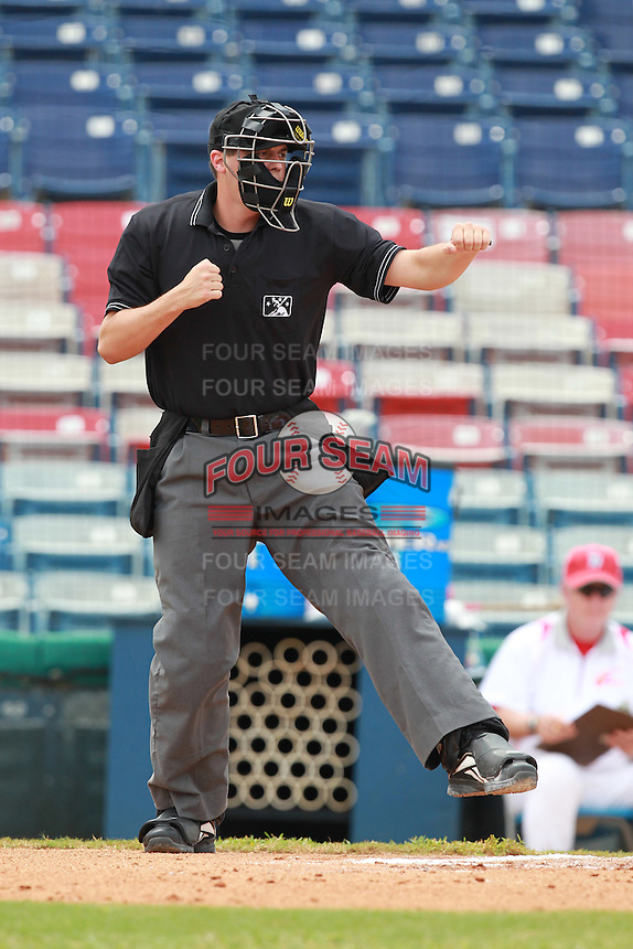 Home plate umpire Shaun Lampe during a game between the China National Team and Washington Nationals Instructional League team at Holman Stadium in Vero Beach, Florida September 30, 2010.   Photo By Mike Janes/Four Seam Images
