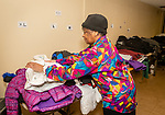 WATERBURY, CT. 21 December 2019-122119BS283 - Deborah Gatling of Waterbury puts more coats and other clothes on the table for people to pick from at the Refuge Church of Christ on Saturday. People could get coats, jackets, hats and gloves to keep warm for the winter season as well as a hot meal. Bill Shettle Republican-American