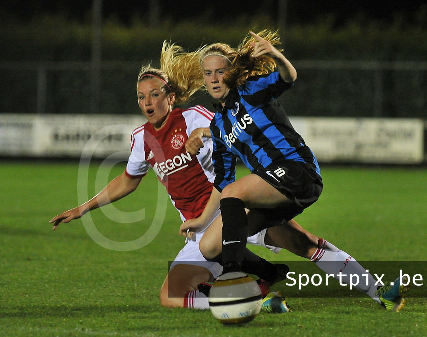20130830 - VARSENARE , BELGIUM : Brugge's Silke Demeyere (right) and Ajax'  Anouk Hoogendijk (left) pictured during the female soccer match between Club Brugge Vrouwen and Ajax Amsterdam Dames , of the first matchday in the BENELEAGUE competition. Friday 30 August 2013. PHOTO DAVID CATRY