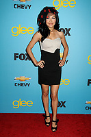 "13 July 2020 - Naya Rivera, the actress best known for playing cheerleader Santana Lopez on Glee, has been confirmed dead. Rivera, 33, is believed to have drowned while swimming in the lake with her 4-year-old son, who was found asleep on their rental pontoon boat after it was overdue for return. 12 April 2010 - West Hollywood, California - Naya Rivera. Fox's ""Glee"" Spring Premiere Soiree held at Bar Marmont. Photo Credit: Byron Purvis/AdMedia"