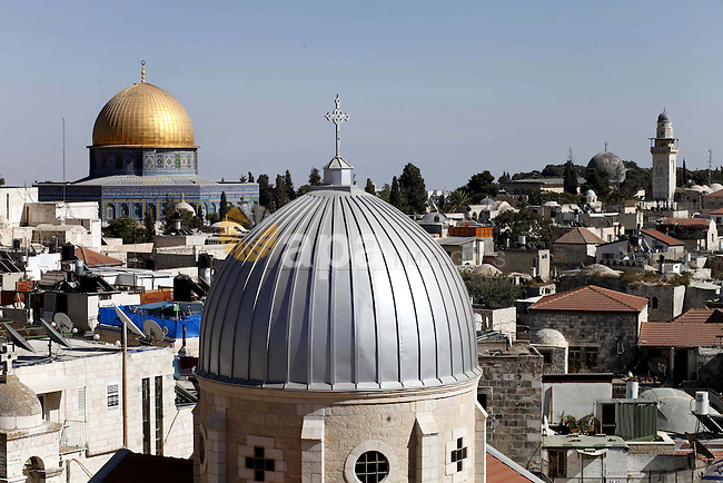 The dome of The Russian Orthodox Church on the Mount of Olives is seen in the foreground and the Dome of the Rock in background in Jerusalem's old city on Sep. 16, 2013. Photo by Saeed Qaq