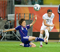 Ali Krieger (11) of the United States crosses the ball past Aya Miyama (8) of Japan during the final of the FIFA Women's World Cup at FIFA Women's World Cup Stadium in Frankfurt Germany.  Japan won the FIFA Women's World Cup on penalty kicks after tying the United States, 2-2, in extra time.