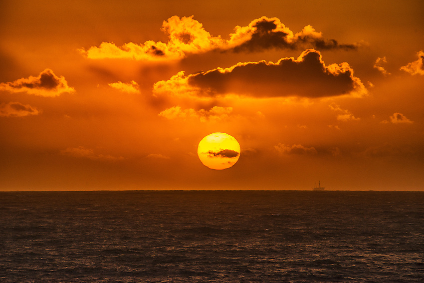A sunset over the Pacific Ocean viewed from the coast at Laguna Beach, California