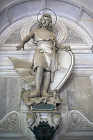 Pictures of the stone sculpture of St George and the dragon on the Pastorino Family Tomb, 1881. The monumental tombs of the Staglieno Monumental Cemetery, Genoa, Italy