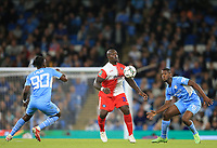 21st September 2021; Etihad Stadium,Manchester, England; EFL Cup Football Manchester City versus Wycombe Wanderers; Adebayo Akinfenwa of Wycombe Wanderers controls the ball under pressure from Romeo Lavia and Mbete of Manchester City
