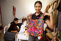 """Italy. Lazio region. Rome. The Cooperativa Sociale Antica Sartoria Rom was created in 2006 by a group of gypsy women who have decided to design clothes based on the gypsy culture. Magdalena Dinca (L) and Nadia Dumitru (R)   both gypsy, are working on sewing machines fixing new clothes. Both women are immigrants in Italy and live permanently in a gypsy camp on the ouskirts of Rome. The Cooperativa Sociale Antica Sartoria Rom is located in the basement of the political party """" Partito della Rifondazione Communista"""" , S.E. Circolo Esquilino Morti-Celio """"Maria Zevi"""". Romanian immigration. The Romani, who are known collectively in the Romani language as Romane or Rromane (depending on the dialect concerned) and also as Romany, Romanies, Romanis, Roma, Romsor or Rroms, are an ethnic group living mostly in Europe. Romanian immigration. 28.09.2011 © 2011 Didier Ruef"""