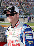 Sprint Cup Series driver Dale Earnhardt Jr. (88) is waiting for the driver introductions before during the Nascar Sprint Cup Series AAA Texas 500 race at Texas Motor Speedway in Fort Worth,Texas. Sprint Cup Series driver Jimmie Johnson (48) wins the AAA Texas 500 race.