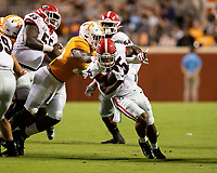 KNOXVILLE, TN - OCTOBER 5: Daniel Bituli #35 of the Tennessee Volunteers tackles Brian Herrien #35 of the Georgia Bulldogs and is called for a personal foul during a game between University of Georgia Bulldogs and University of Tennessee Volunteers at Neyland Stadium on October 5, 2019 in Knoxville, Tennessee.