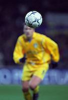 Football player running towards the ball