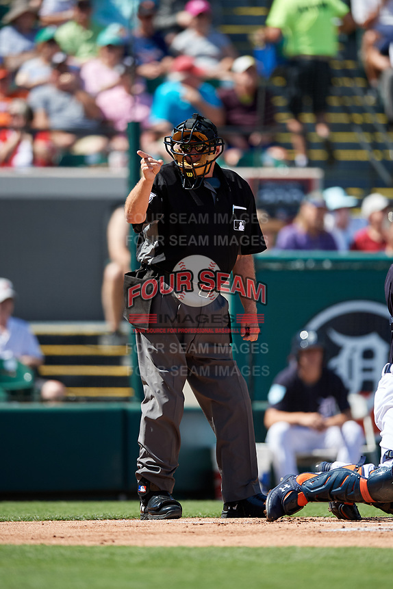 Home plate umpire Jerry Layne calls a strike during a Grapefruit League Spring Training game between the Atlanta Braves and the Detroit Tigers on March 2, 2019 at Publix Field at Joker Marchant Stadium in Lakeland, Florida.  Tigers defeated the Braves 7-4.  (Mike Janes/Four Seam Images)