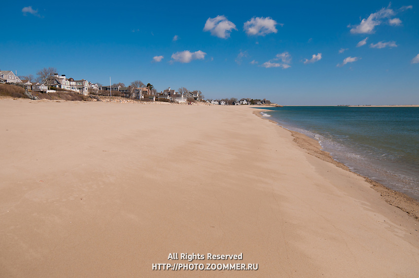 Empty strand of lighthouse beach In low season in Chatham, Cape Cod