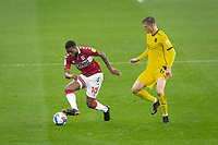 3rd October 2020; Riverside Stadium, Middlesbrough, Cleveland, England; English Football League Championship Football, Middlesbrough versus Barnsley; Chuba Akpom of Middlesbrough FC  in action shadowed by Mads Juel Andersen of Barnsley FC