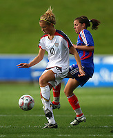 Kristie Mewis (USA) and Lea Rubio (FRA)..FIFA U17 Women's World Cup, USA v France, Albany Stadium, Auckland, New Zealand, Wednesday 5 November 2008. Photo: Renee McKay/PHOTOSPORT
