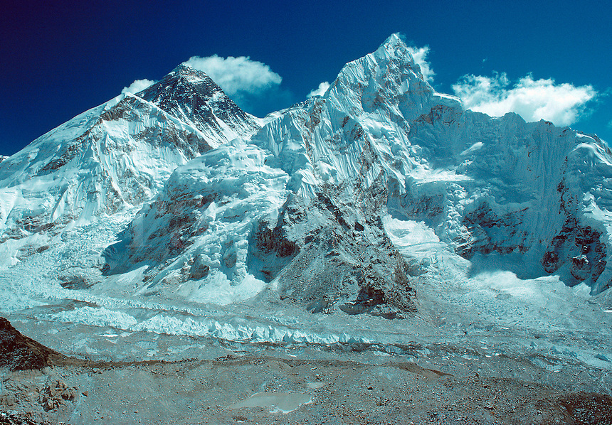 .Everest (left) and Nuptse from the south ridge of Pumo Ri, Khumbu region, Nepal Himalaya. The South Col of Everest is visible between the two mountains..