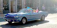 Marc Hayot/Herald Leader A classic Mustang drives by displaying the colors of the U.S. Air Force.