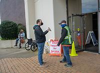 Norfolk VA ,April 1,2021- A man shows a FEMA specialist his pre-registration notice for the COVID-19 vaccine at the Norfolk, VA community center.  <br /> CAP/MPI/PYL<br /> ©PYL/MPI/Capital Pictures