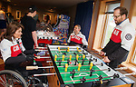Calgary, AB - June 5 2014 - Collette Bourgonje and Kurt Oatway play some Foosball during the Celebration of Excellence Heroes Tour visit to Ronald McDonald House in Calgary. (Photo: Matthew Murnaghan/Canadian Paralympic Committee)