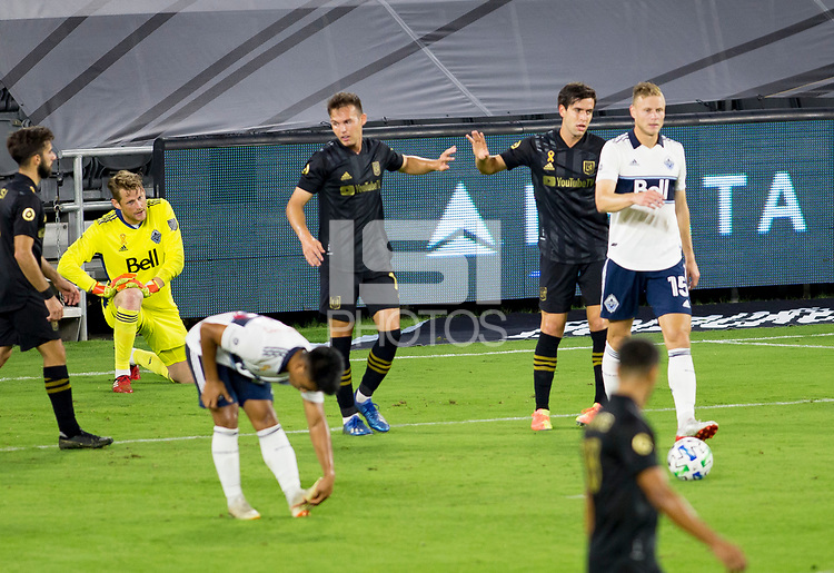 LOS ANGELES, CA - SEPTEMBER 23: Danny Musovski #16 of the Los Angeles football club celebrates a goal with team mate Francisco Ginella #8 during a game between Vancouver Whitecaps and Los Angeles FC at Banc of California Stadium on September 23, 2020 in Los Angeles, California.