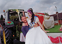 """Queen of Barwell, Charlotte Wilson is assisted from her carriage by her driver, Mr Dave Thorley.<br /> <br /> """"What is the worldís best song to dance to? """""""