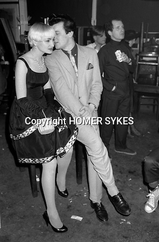 Blitz Kids New Romantics at The Blitz Club Covent Garden, London, England 1980.<br /> <br /> Judy Harrison (nee Scadding) with whispering gent, writer Chris Sullivan. Steve Mahoney in black with can of beer.