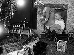 Wilkinsburg PA:  Brady Jr and Helen Stewart checking out the toys under the Christmas Tree.  The ghost effect on Helen is a result of the long camera exposure required to capture the image.