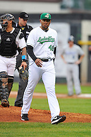 Pitching coach Cibney Bello #48 of the Clinton LumberKings walks off the mound against the West Michigan Whitecaps at Ashford University Field on July  25, 2014 in Clinton, Iowa. The Whitecaps won 9-0.   (Dennis Hubbard/Four Seam Images)