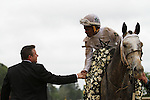 HOT SPRINGS, AR - April 16: Jockey Ricardo Santana, Jr. receives congratulations from Whitmore's trainer, Ron Moquett, after winning the Arkansas Derby at Oaklawn Park on April 16, 2016 in Hot Springs, AR. (Photo by Ciara Bowen/Eclipse Sportswire/Getty Images)
