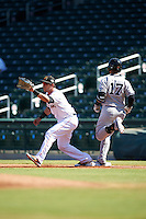 Mesa Solar Sox Austin Nola (8), of the Miami Marlins organization, stretches for a throw as Gleyber Torres (17) runs through the bag during a game against the Scottsdale Scorpions on October 21, 2016 at Sloan Park in Mesa, Arizona.  Mesa defeated Scottsdale 4-3.  (Mike Janes/Four Seam Images)