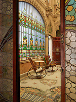 A stained glass doorway marks the entrance to the Inner Garden, with its impressive stained glass window leading the eye up to the elaborate stone carving above