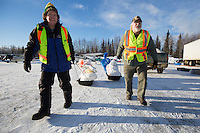 Volunteers move musher drop bags to waitng Iditarod Air Force planes at the Willow, Alaska airport during the Food Flyout on Saturday, February 20, 2016.  Iditarod 2016
