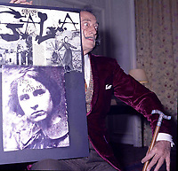 "portrait of Salvador Dali in his suite at hotel Maurice Paris,<br /> 1973,<br /> , - Salvador Domènec Felip Jacint Dalí i Domènech, Marquis de Púbol (May 11, 1904 – January 23, 1989), commonly known as Salvador Dalí  was a prominent Spanish Catalan surrealist painter born in Figueres.<br /> <br /> Dalí was a skilled draftsman, best known for the striking and bizarre images in his surrealist work. His painterly skills are often attributed to the influence of Renaissance masters.His best-known work, The Persistence of Memory, was completed in 1931. Dalí's expansive artistic repertoire includes film, sculpture, and photography, in collaboration with a range of artists in a variety of media.<br /> <br /> Dalí attributed his ""love of everything that is gilded and excessive, my passion for luxury and my love of oriental clothes to a self-styled ""Arab lineage,"" claiming that his ancestors were descended from the Moors.<br /> <br /> Dalí was highly imaginative, and also had an affinity for partaking in unusual and grandiose behavior. His eccentric manner and attention-grabbing public actions sometimes drew more attention than his artwork to the dismay of those who held his work in high esteem and to the irritation of his critics -"