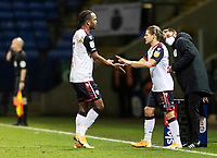 Bolton Wanderers' Lloyd Isgrove (right) replaces Nathan Delfouneso <br /> <br /> Photographer Andrew Kearns/CameraSport<br /> <br /> The EFL Sky Bet League Two - Bolton Wanderers v Salford City - Friday 13th November 2020 - University of Bolton Stadium - Bolton<br /> <br /> World Copyright © 2020 CameraSport. All rights reserved. 43 Linden Ave. Countesthorpe. Leicester. England. LE8 5PG - Tel: +44 (0) 116 277 4147 - admin@camerasport.com - www.camerasport.com